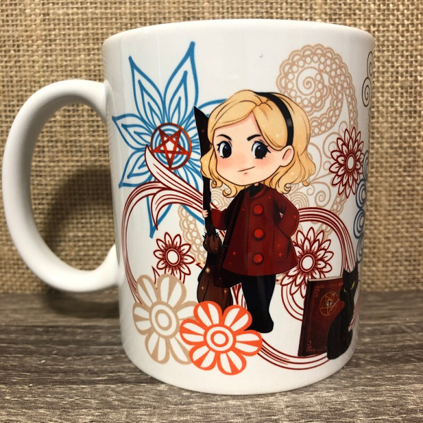 A paisley print coffee mug featuring a stylized version of Sabrina Spellman from Chilling Adventures of Sabrina.
