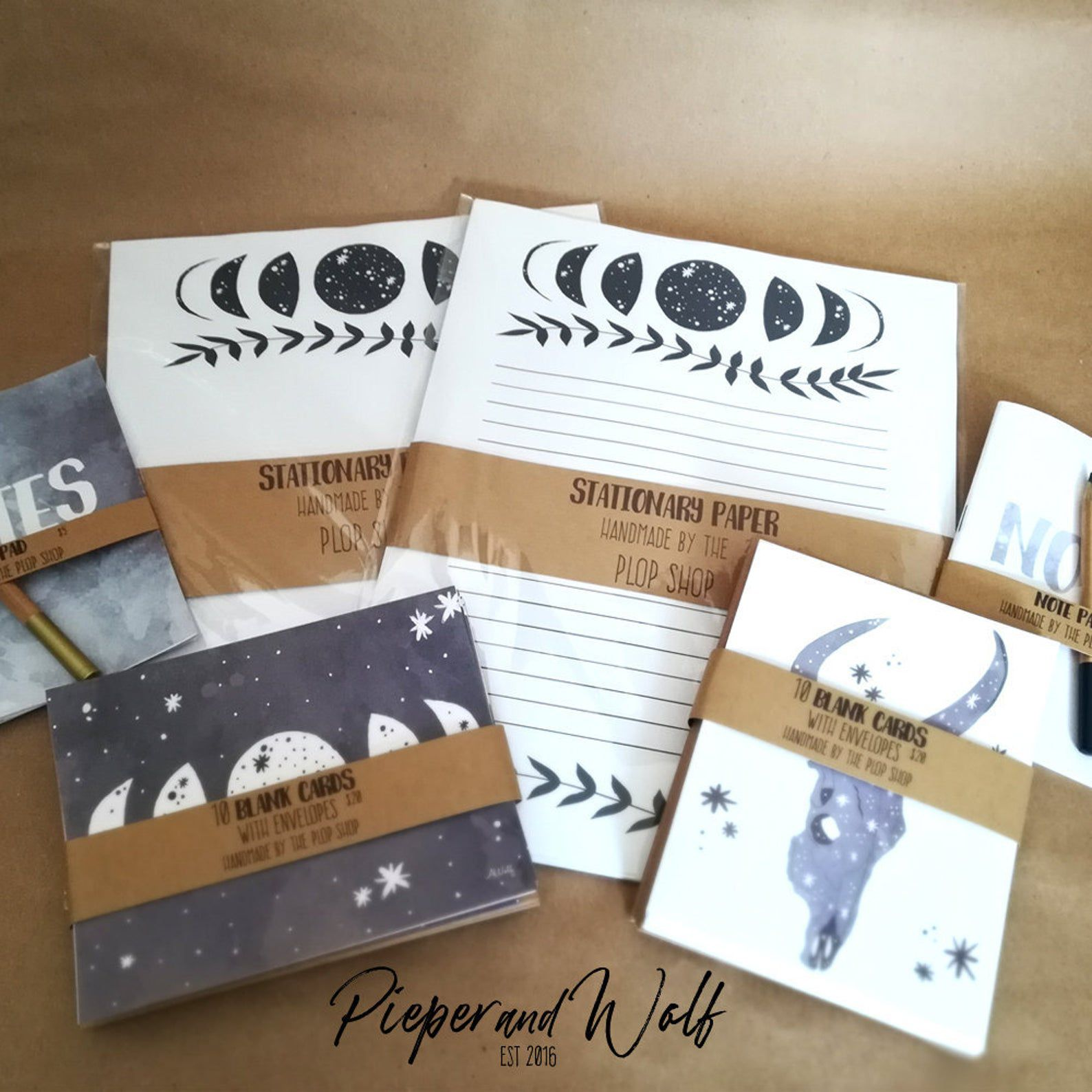 Cards and paper featuring moon phases and desert skulls.