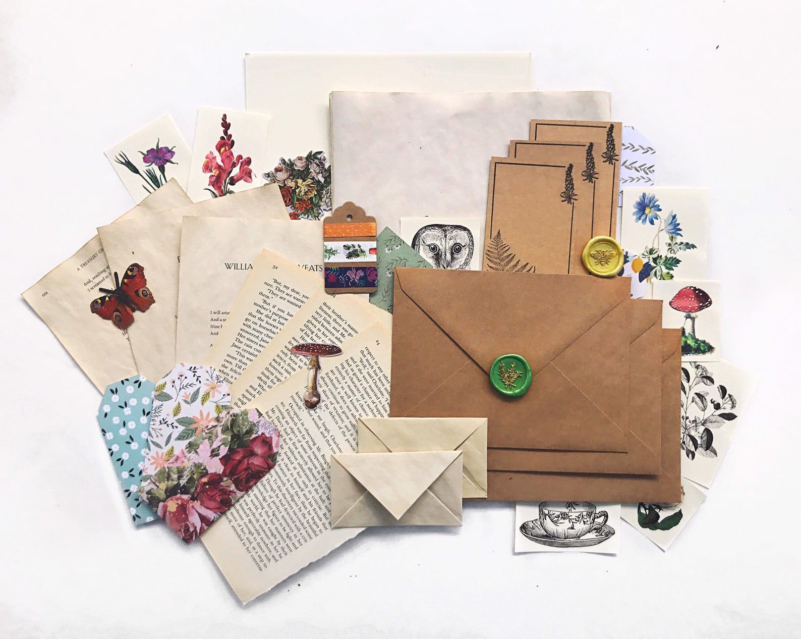 cottage core inspired stationary kit, including paper, envelopes, and stickers