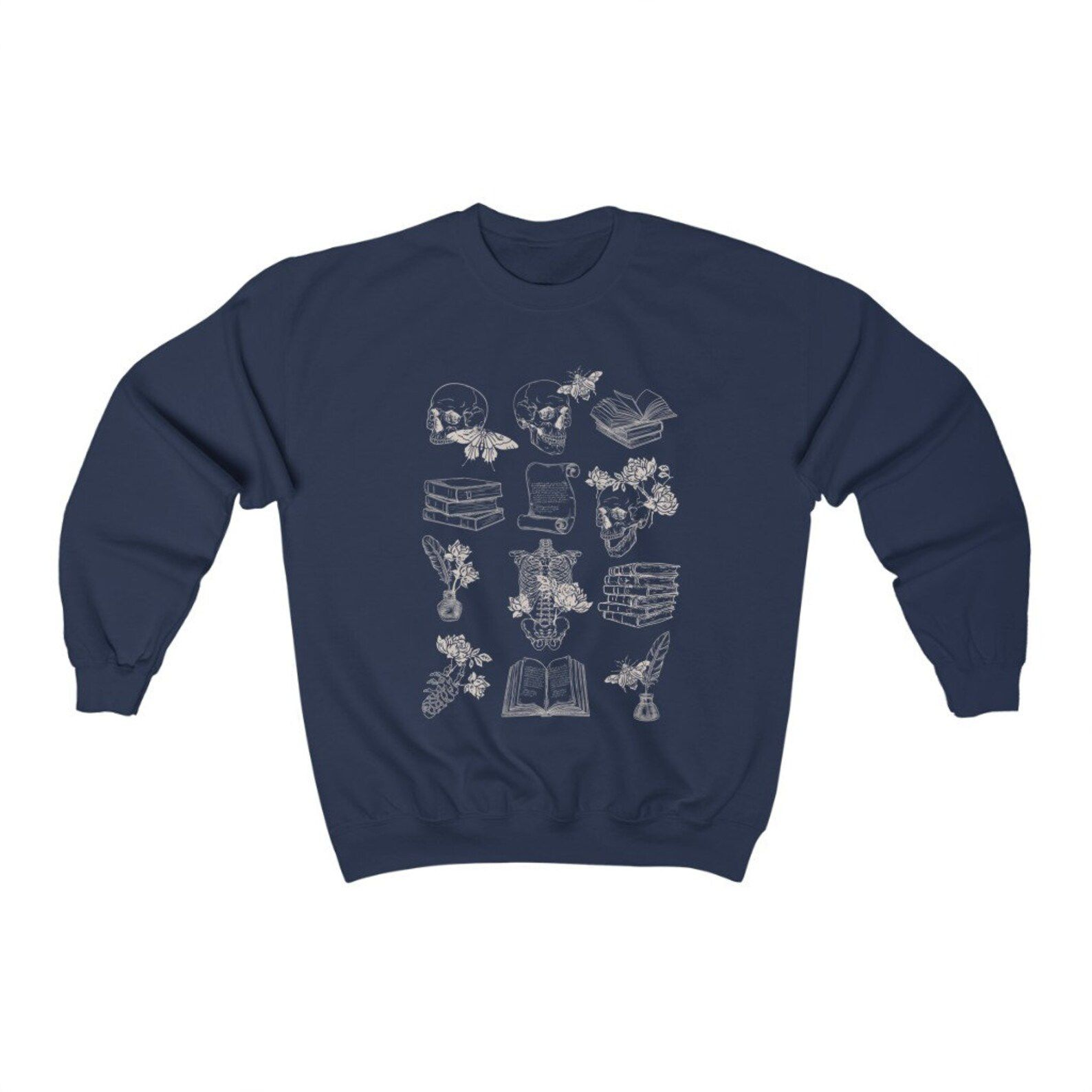 Image of a blue sweatshirt. In the center are images of skulls, moths, books, and a skeleton, all in white ink.