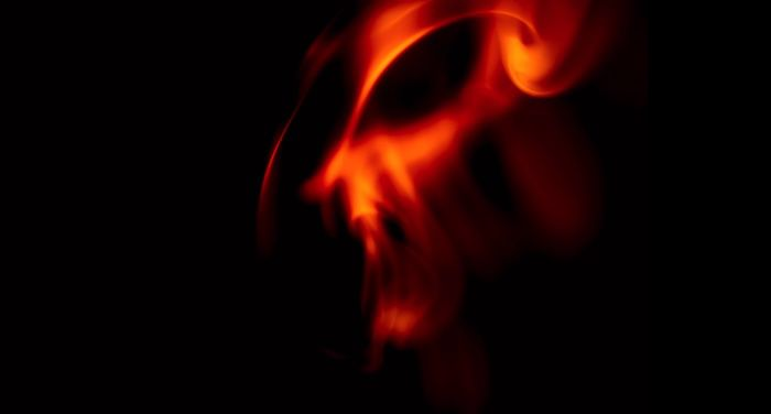 a fiery demonic face against a black background