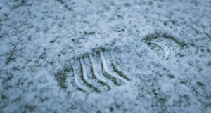 a closeup of a footprint in the snow