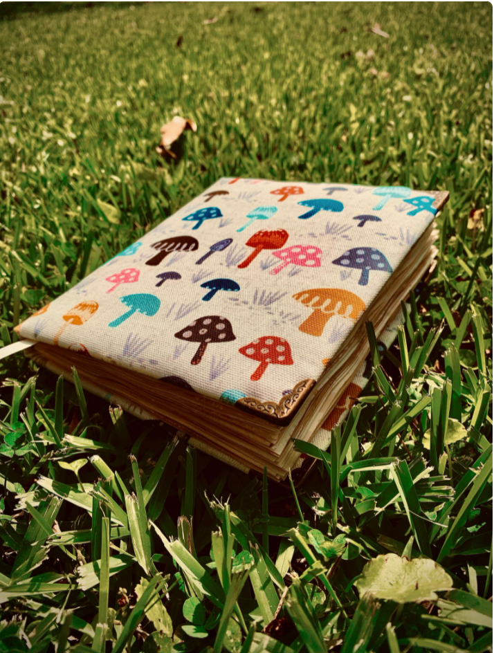 Mushroom notebook with a cream background, made of fabric.