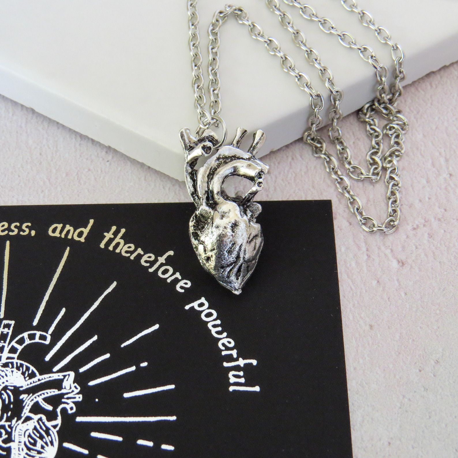 Silver anatomical heart charm on a silver chain