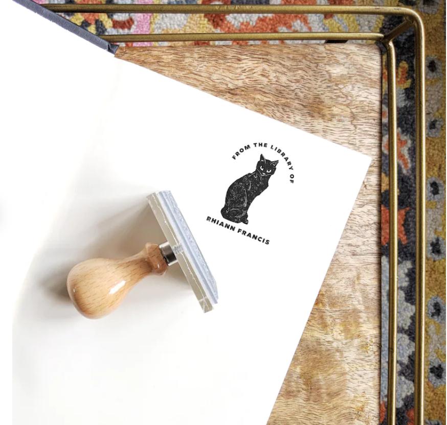 Image of a black cat ex libris stamp.
