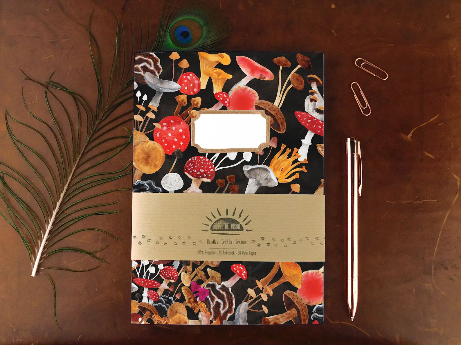 Black notebook with bright colored mushrooms.