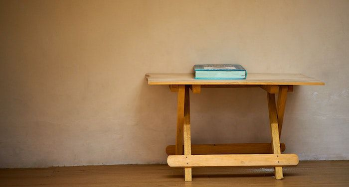 Image of a big book on a wooden table