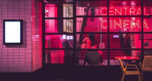 image of a cinema with pink lighting