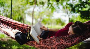 Image of a Teenager Reading In a Hammock