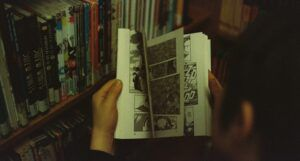 Image of young person flipping through a comic