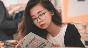 Image of tween reading a book