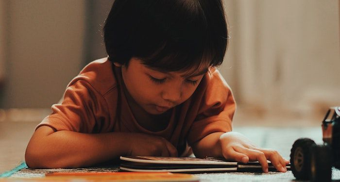 image of a child reading a book