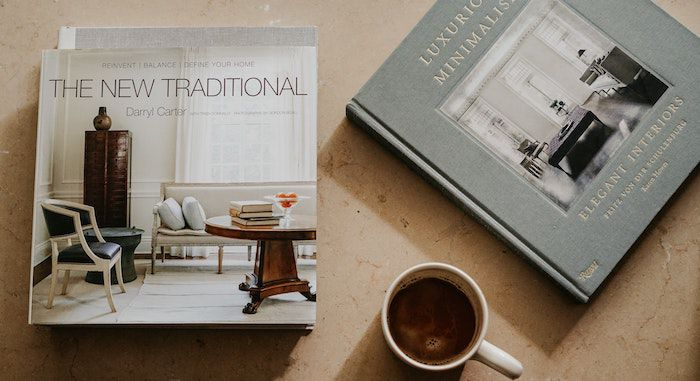 Image of coffee table books and cup of coffee