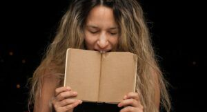 Image of a person biting a book