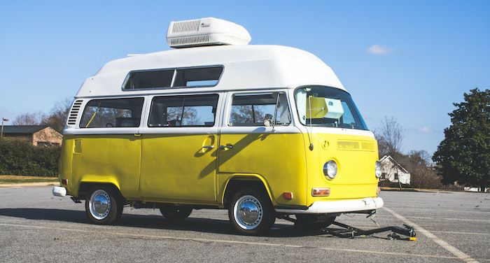 Image of yellow and white camper style truck
