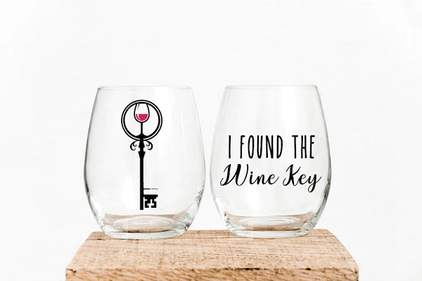 Two stemless wine glasses, side by side.  One said,