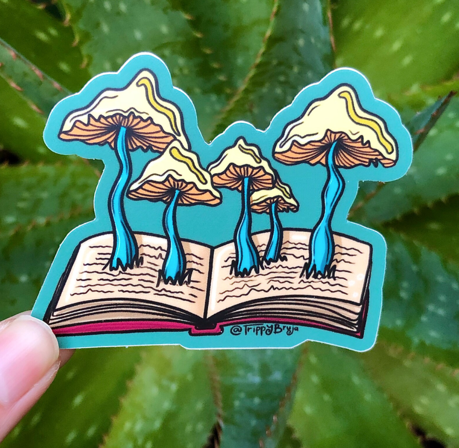 Blue sticker with an open book and five mushrooms growing out from the pages.