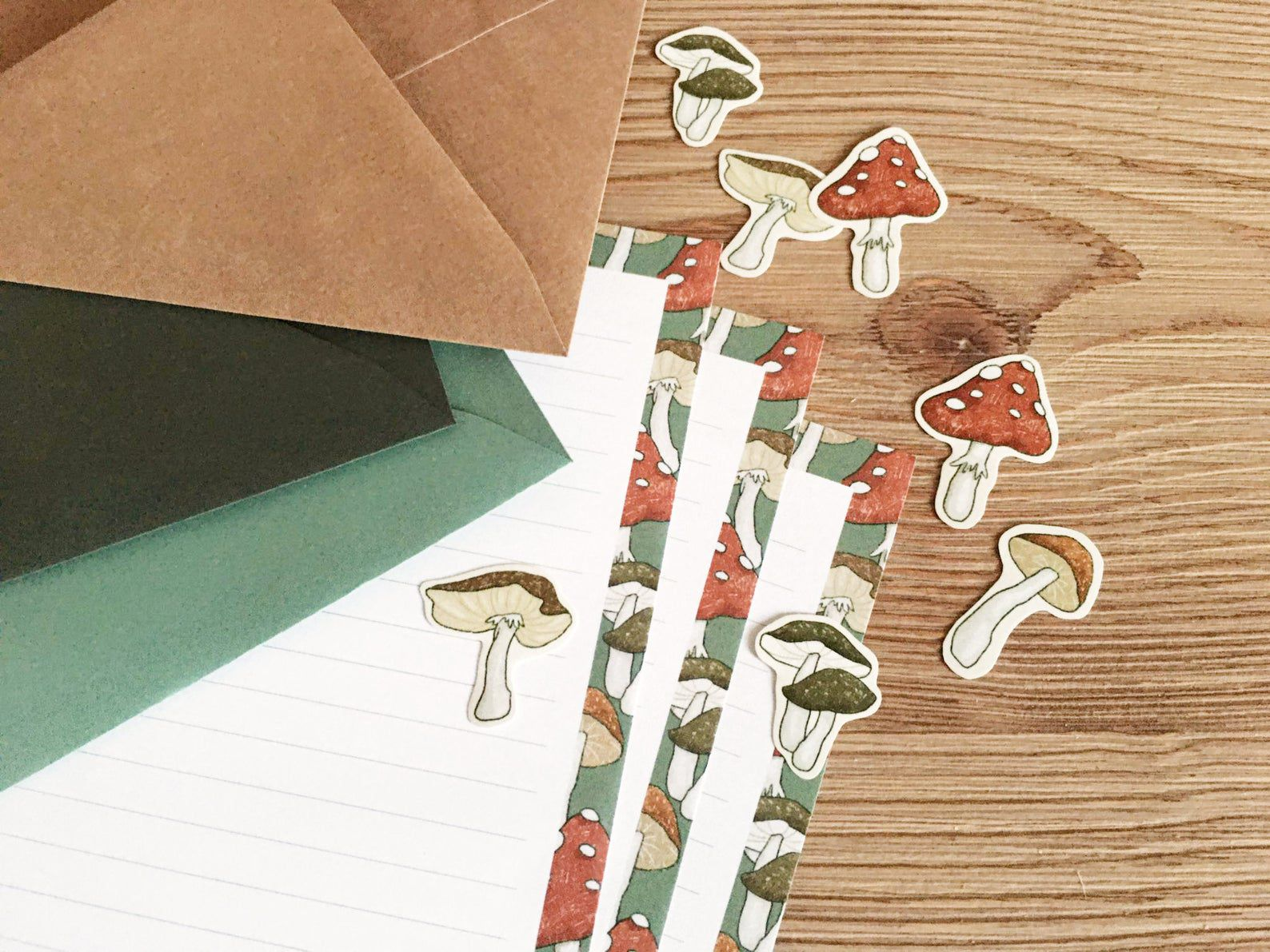 Image of mushroom-themed paper and stickers.