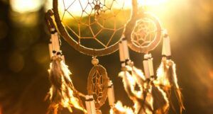 photo of a dream catcher with sunlight streaming through