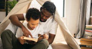 a parent reading a novel-length book to a child