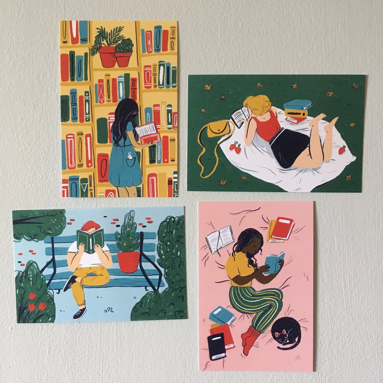 Four illustrated postcards depicting various people reading.