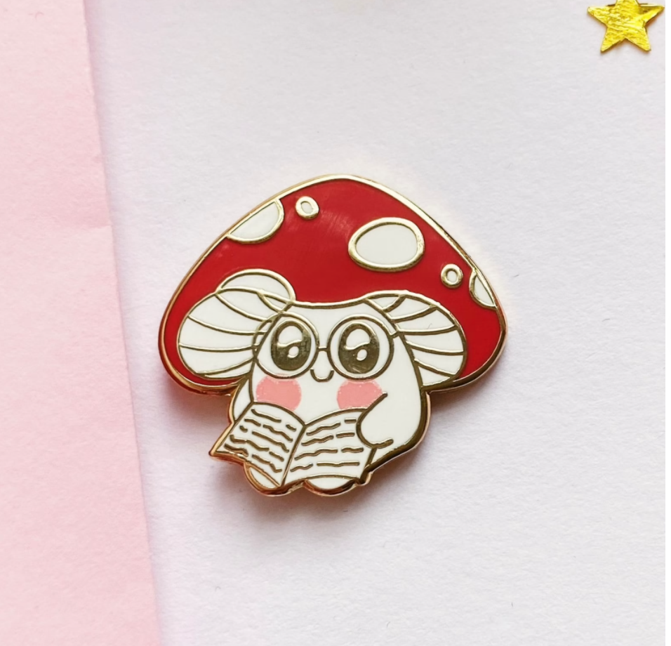 A cartoon style mushroom reading a book.