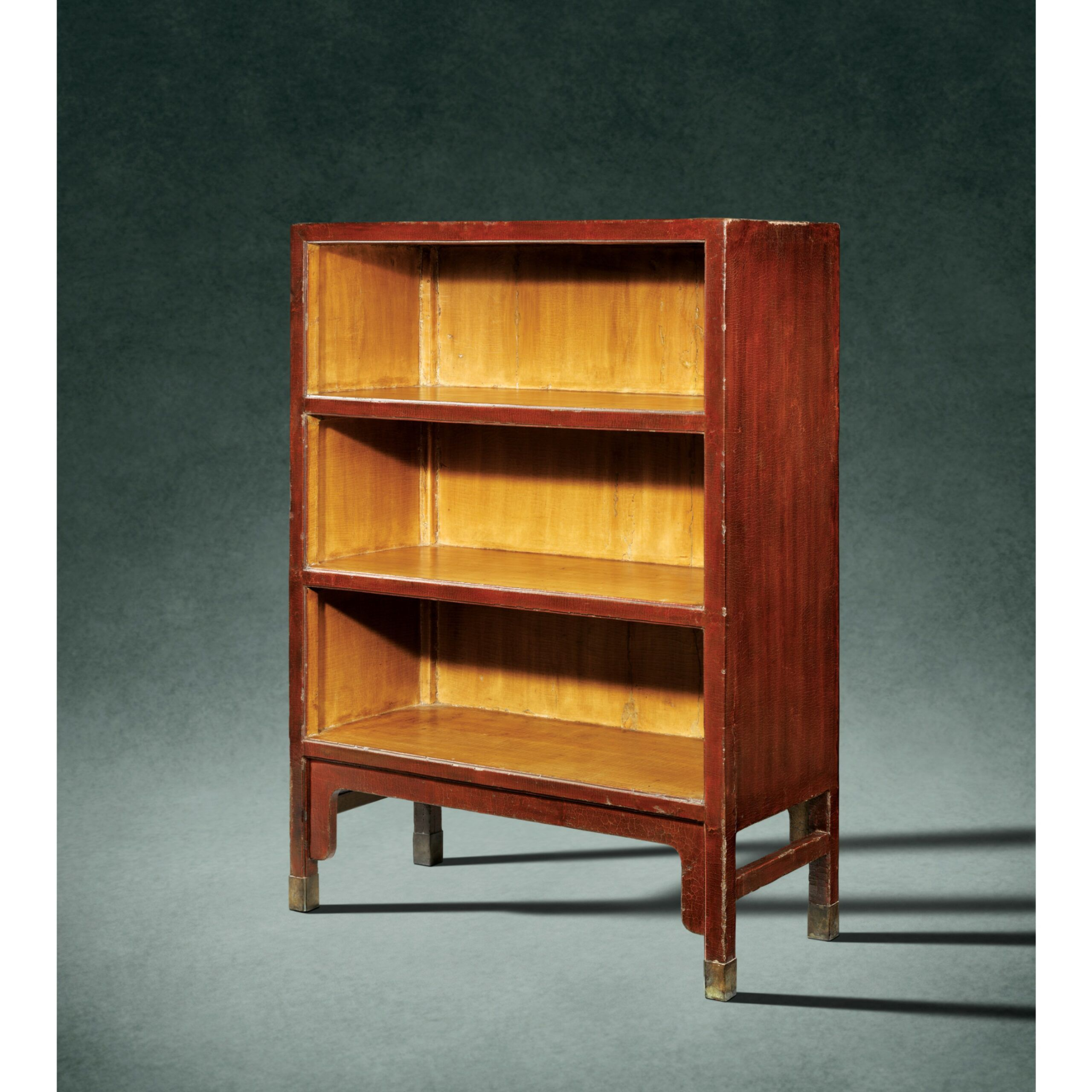 red lacquer bookshelves