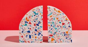 White terrazzo bookends in the shape of an arch