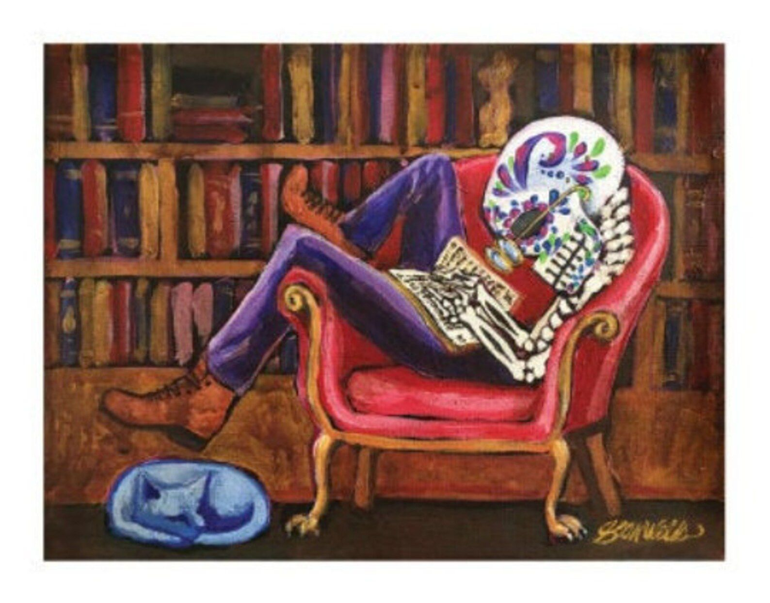 Image of a skeleton with a traditional sugar skull lounging in a red chair reading a book. There's a bookshelf behind the skeleton and a blue cat at the skeleton's feet.