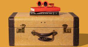 suitcase, sunglasses, and books