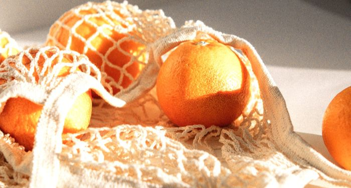 oranges inside a reusable grocery bag