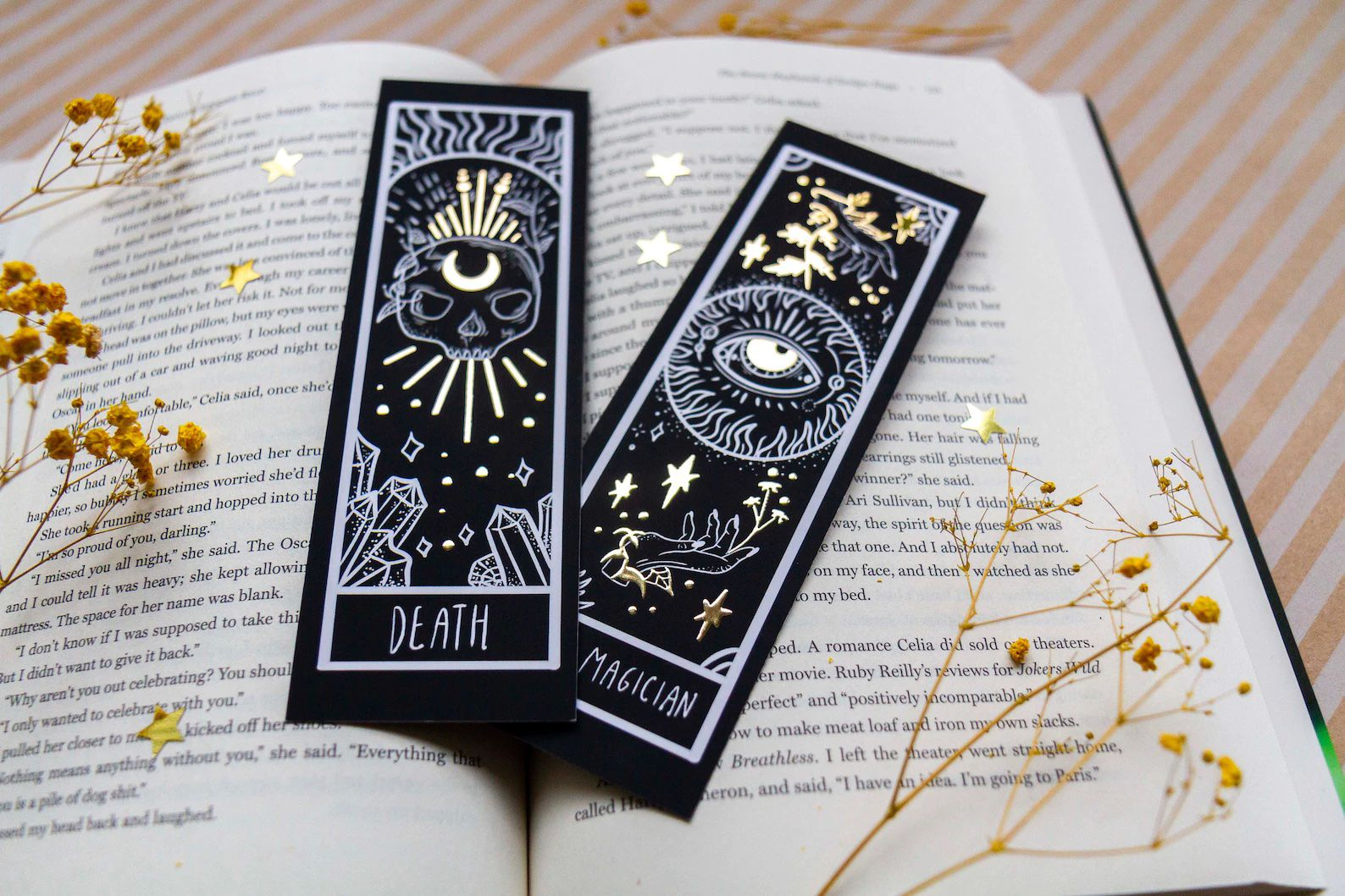 A set of black and gold bookmarks stylized to look like tarot cards