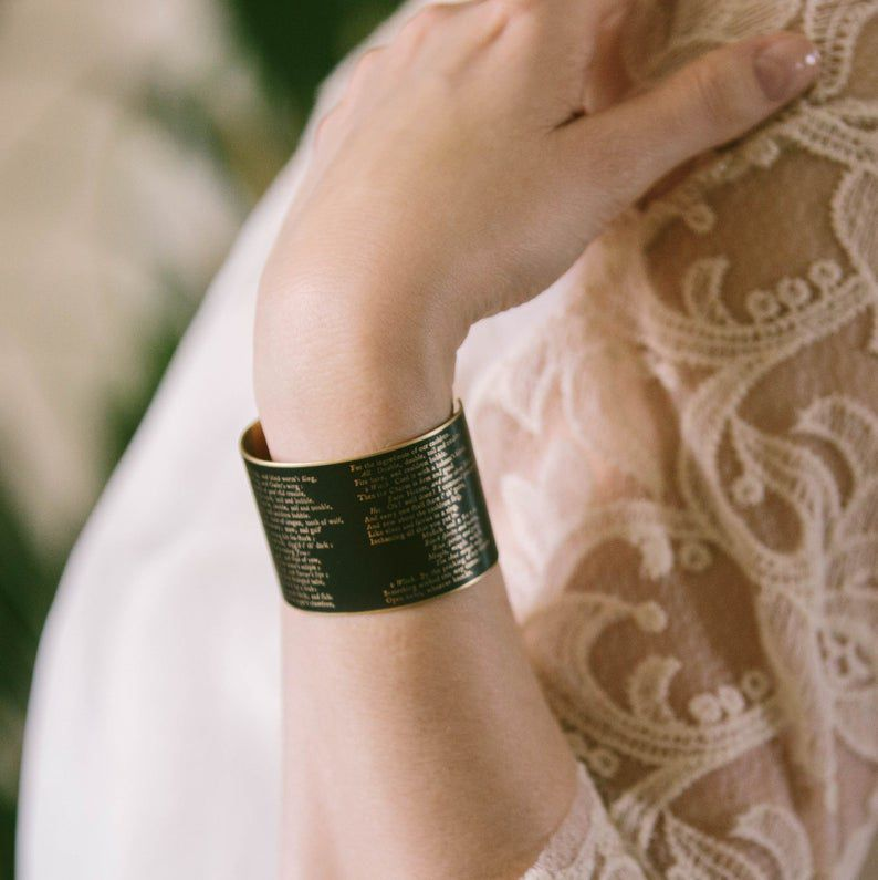 Cuff bracelet with text from Shakespeare's Macbeth.
