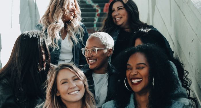 a diverse group of women smiling