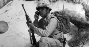 a Navajo Code Talker relaying a message on a field radio during World War Two
