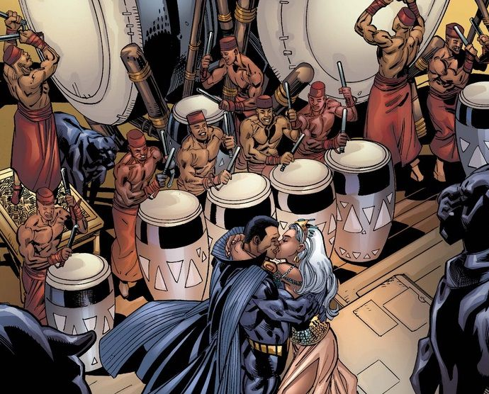 From Black Panther #18. Storm and Black Panther kiss surrounded by drummers and panther statues.