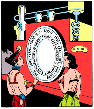 Diana and Hippolyta look at a machine with a round portal on it surrounded by two dials, one that lists a handful of years (1776, 1941, 1300 BC, etc.) and another that lists a handful of locations (Athens, Troy, England, America, etc.).