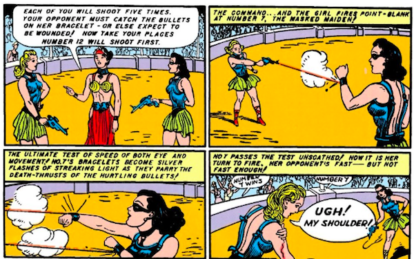 Four panels.  Panel 1: Diana, wearing a mask, and a blonde Amazon face off in an arena, both holding pistols, with Hippolyta presiding.  Hippolyta: Each of you will shoot five times. Your opponent must catch the bullets on her bracelet - or else expect to be wounded! Now take your places. Number 12 will shoot first.  Panel 2: The blonde shoots at Diana, who deflects the bullet with her bracelet.  Narration Box: The command...and the girl fires point-blank at Number 7, the masked maiden!  Panel 3: Diana deflects two more bullets.  Narration Box: The ultimate test of speed of both eye and movement! No. 7's bracelets become silver flashes of streaking light as they parry the death-thrusts of the hurtling bullets!  Panel 4: The blonde grips her bleeding shoulder as the crowd cheers.  Narration Box: No. 7 passes the test unscathed! Now it is her turn to fire. Her opponent's fast - but not fast enough! Blonde: Ugh! My shoulder!