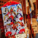 image of anime characters on a shrine in Japan