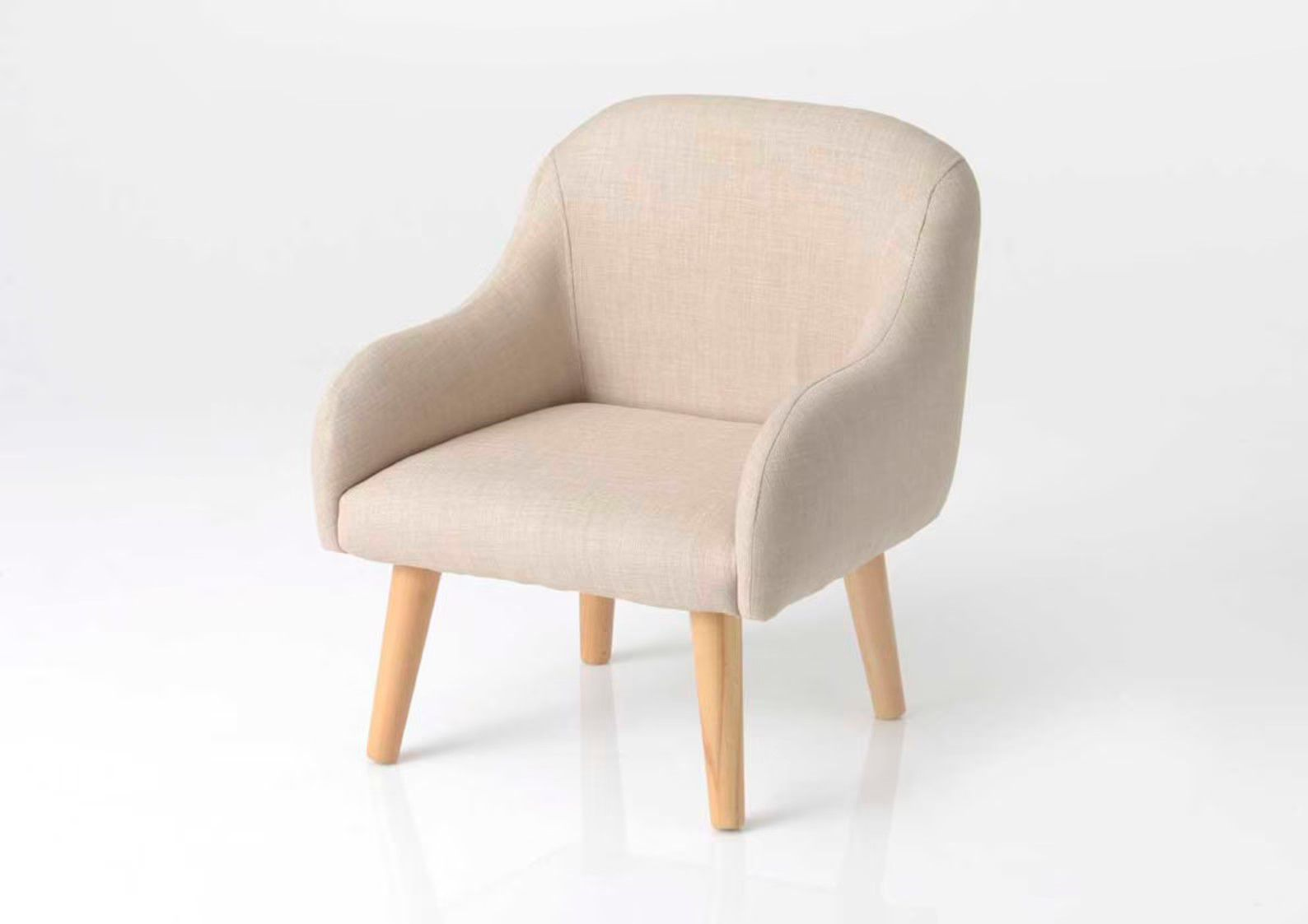 beige chair with light wooden legs