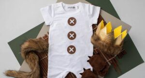 Max from Where the Wild Things Are costume kit: a white romper, gold crown, fuzzy tail and slippers