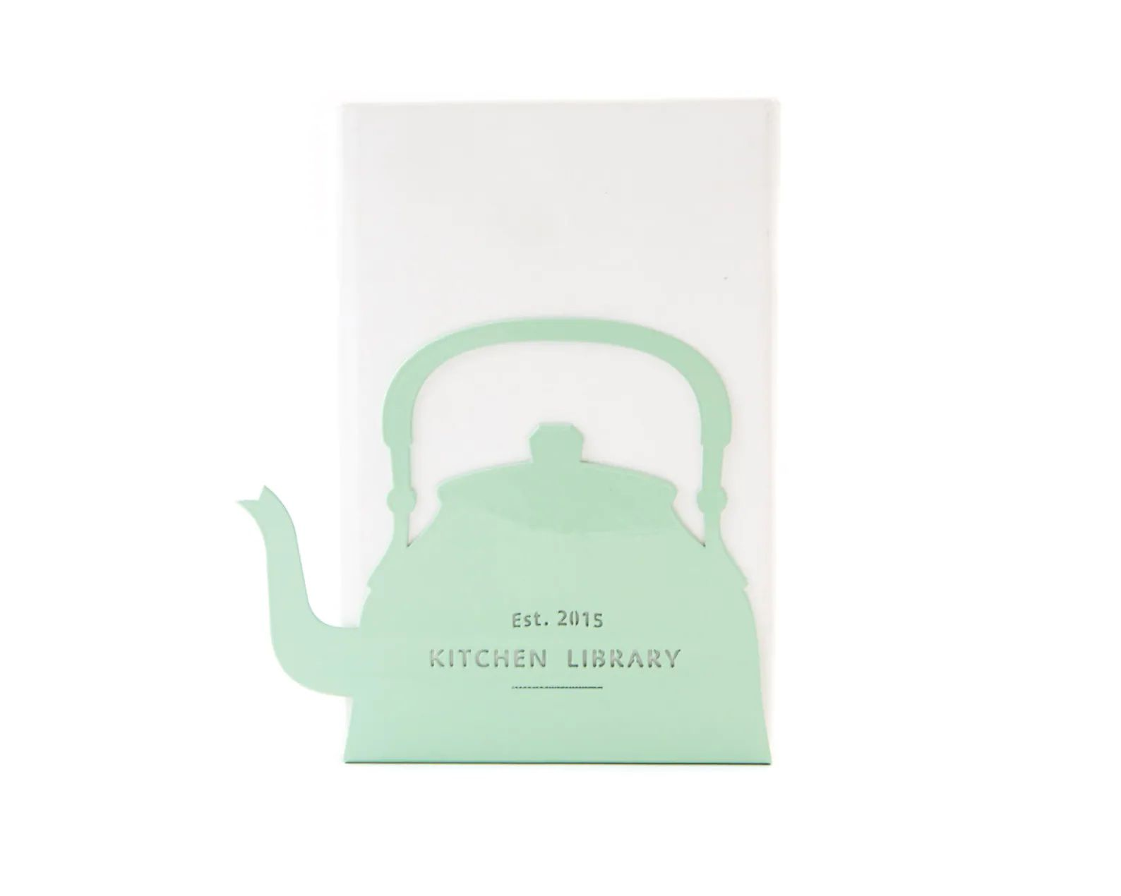 """Mint green metal bookend in the shape of a tea kettle that reads """"Kitchen Library, Est. 2015."""" The text is customizable."""
