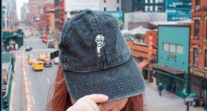 girl wears bookish hat