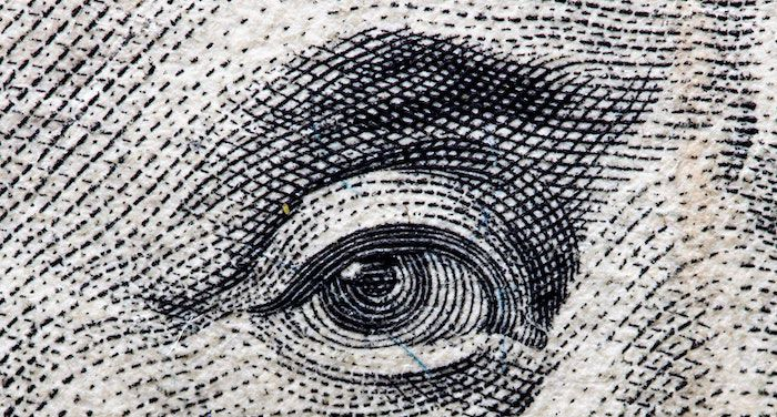 Close up of Ben Franklin's eye from money