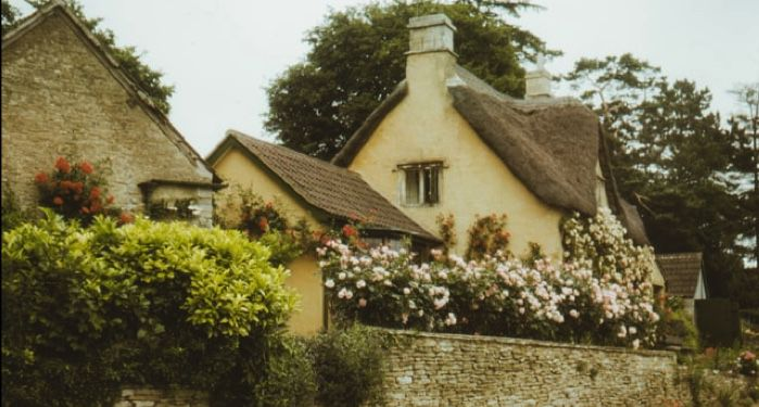 image of an English countryside cottage with flowers and greenery