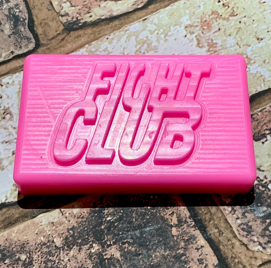 A pink soap with protruding letters spelling fight club