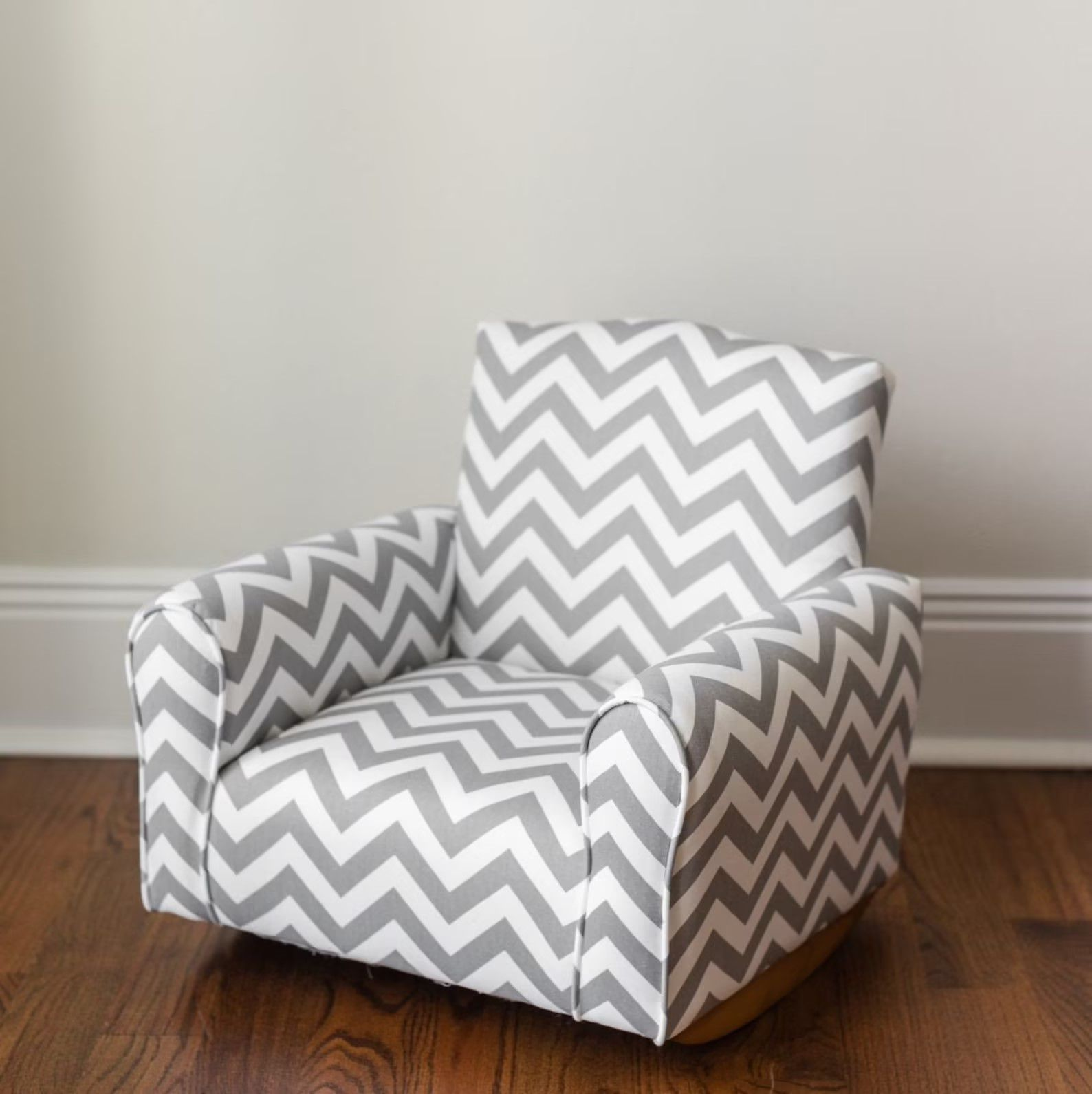 gray and white chevron patterned rocker armchair