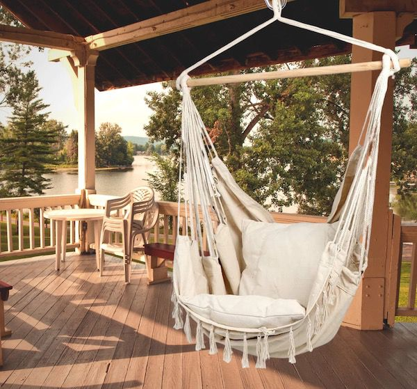 a hammock chair seen hanging outdoors on a patio