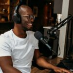 Image of a Black man podcasting