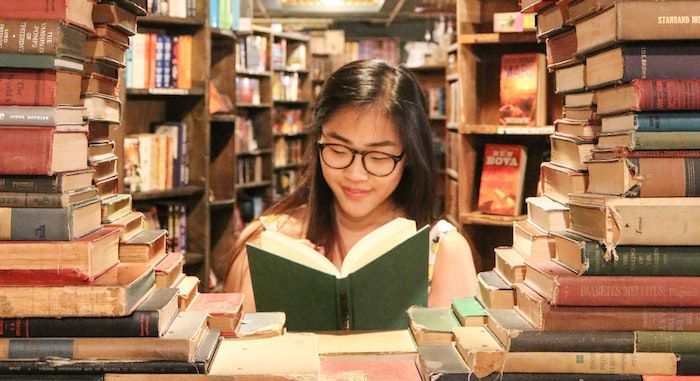 image of an asian woman reading a book